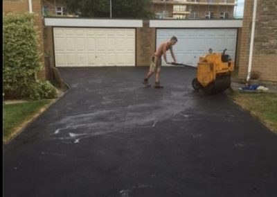 Banbury Roofing and Paving - Rolling the tarmac drive